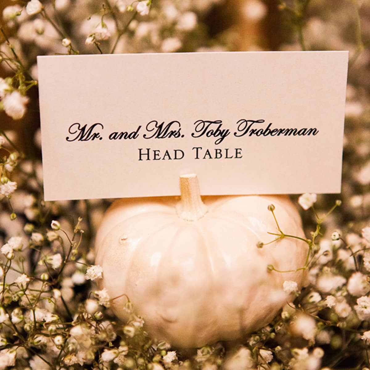 fall wedding austin texas fall wedding favors Painted miniature pumpkins serve as table cards for the seated dinner