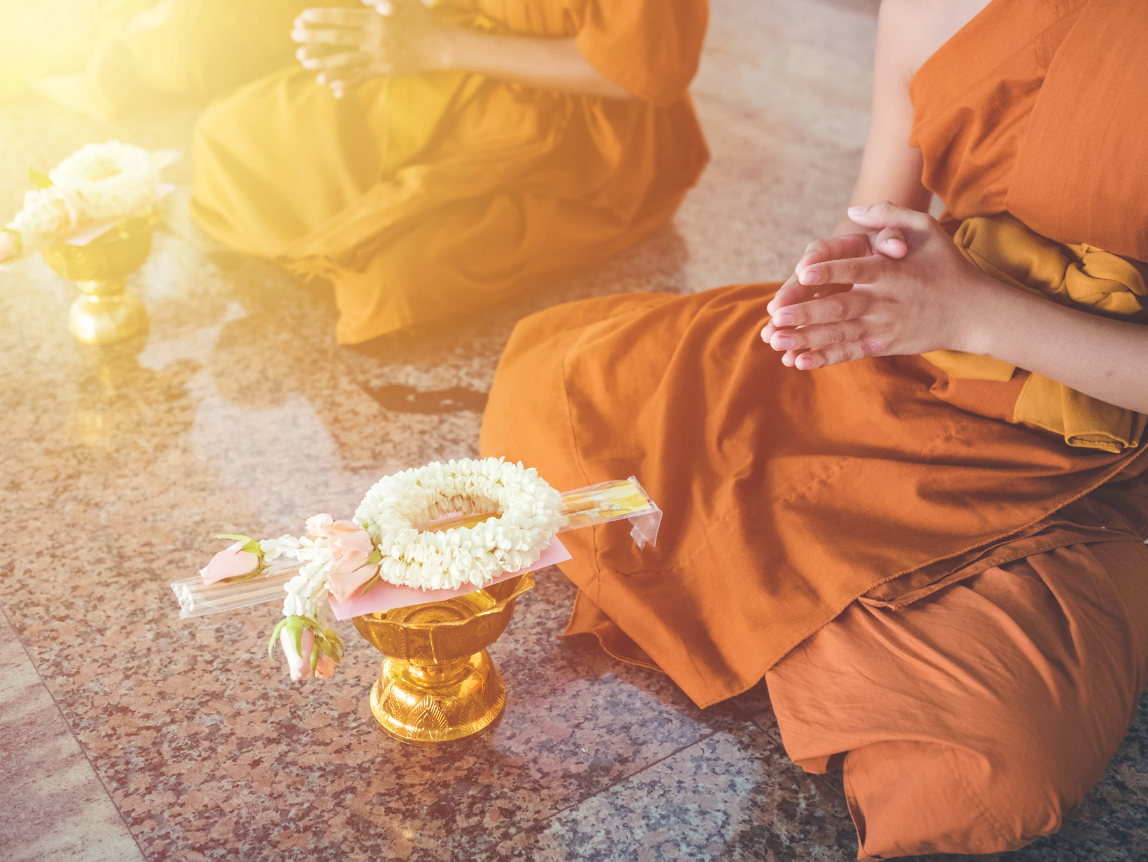 Receive a traditional Buddhist blessing from a monk