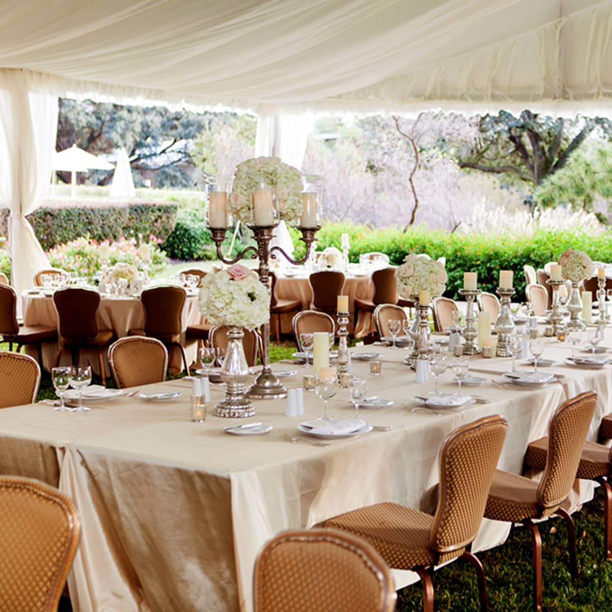 Elegance Reigns Inside The Dinner Tent With Tables Set For Family Style Dining