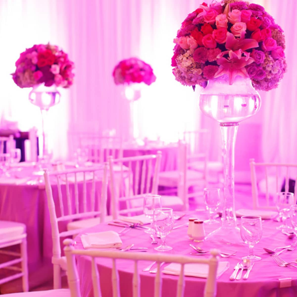 Wedding in jakarta four seasons hotel jakarta high pink centrepieces sit on the reception tables junglespirit Image collections