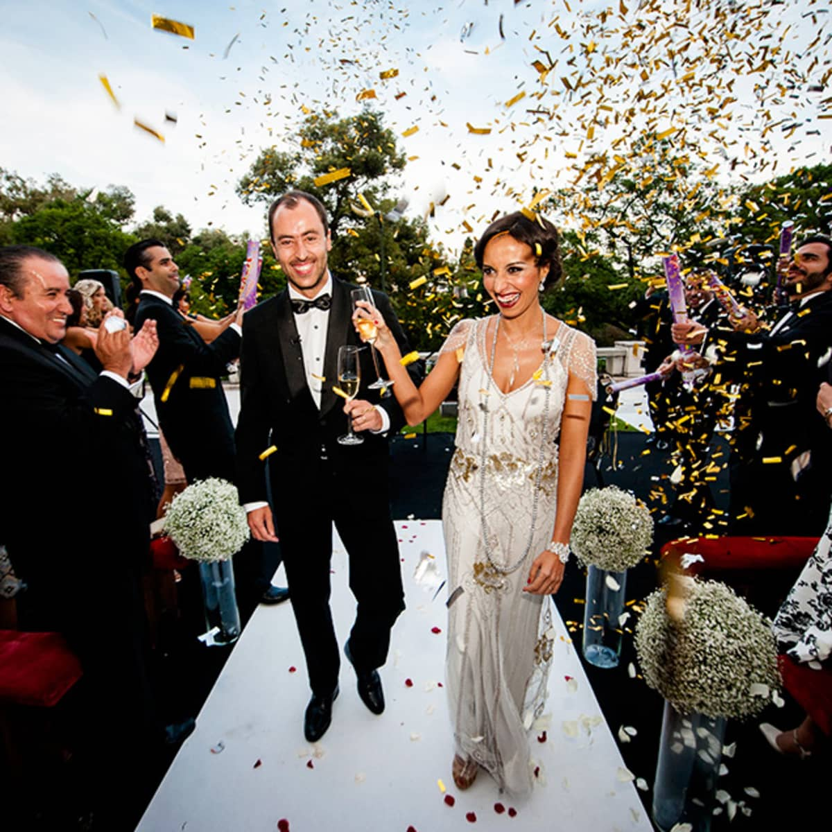 Great gatsby wedding in lisbon four seasons hotel lisbon after the ceremony alexandre and sandra celebrate as they return up the aisle as husband junglespirit Choice Image