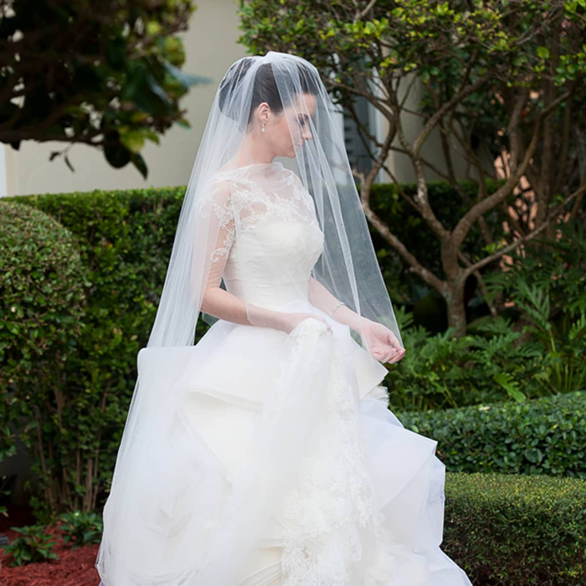 Megan Dons A Chantilly Lace Bolero Wrap And Long Veil For The Ceremony