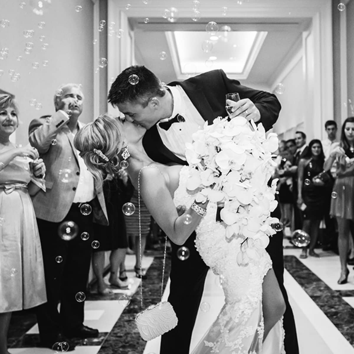 Instead Of Tossing Rice Guests Blow Bubbles As The Newlyweds Make Their Getaway