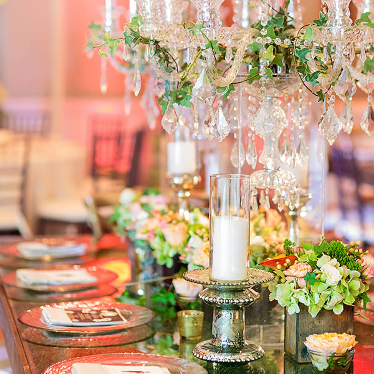 crystal chandeliers and mercury glass candleholders add a sophisticated element to the rustic dcor