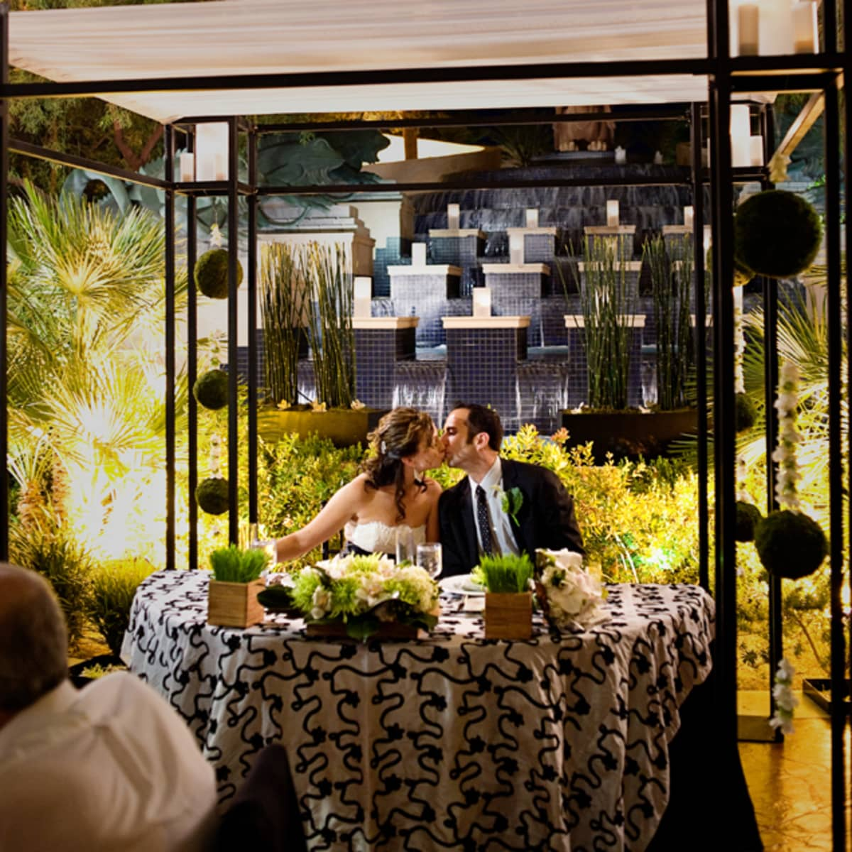 The Newlyweds Dine Underneath Ceremony Canopy