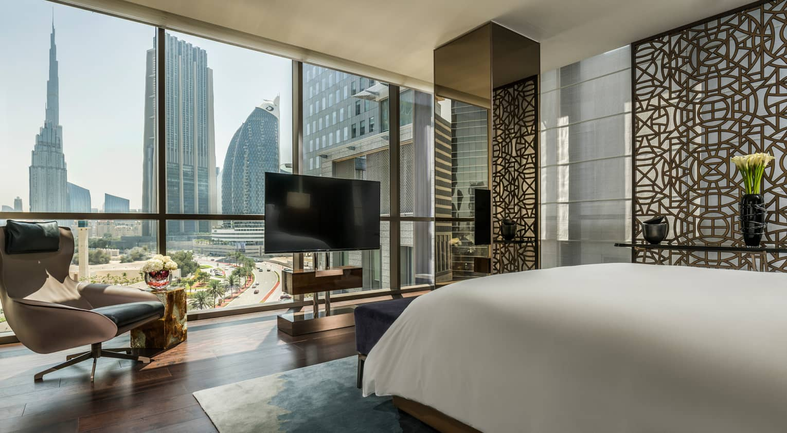 Four Seasons Deluxe Executive Suite room with bed, floor-to-ceiling window with Burj Khalifa view