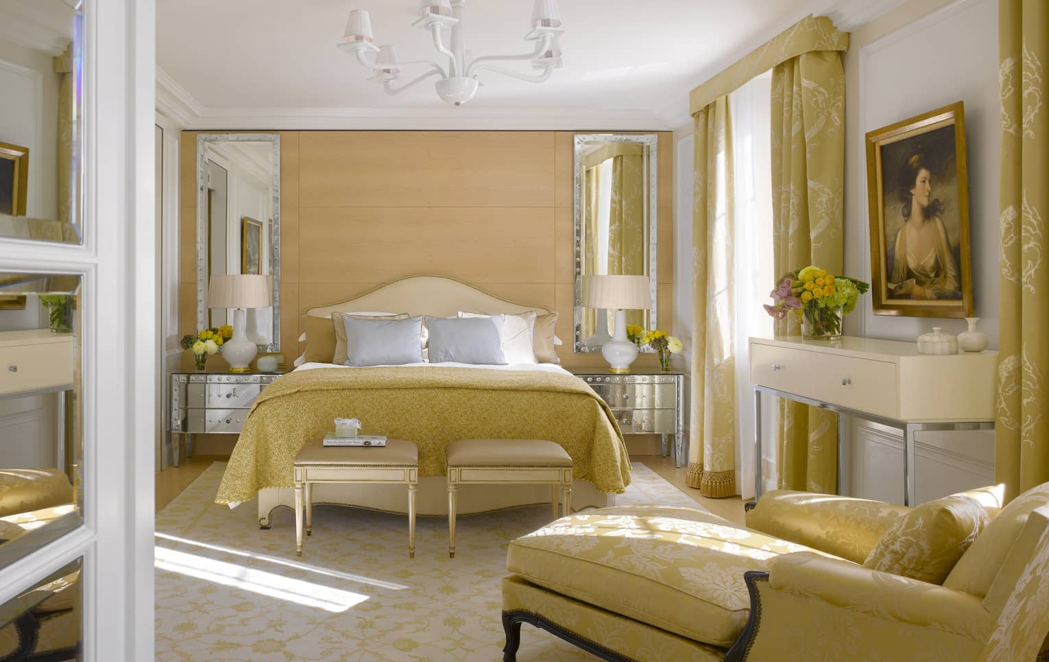 Presidential suite with queen bed, chaise lounge, and gold Victorian accents