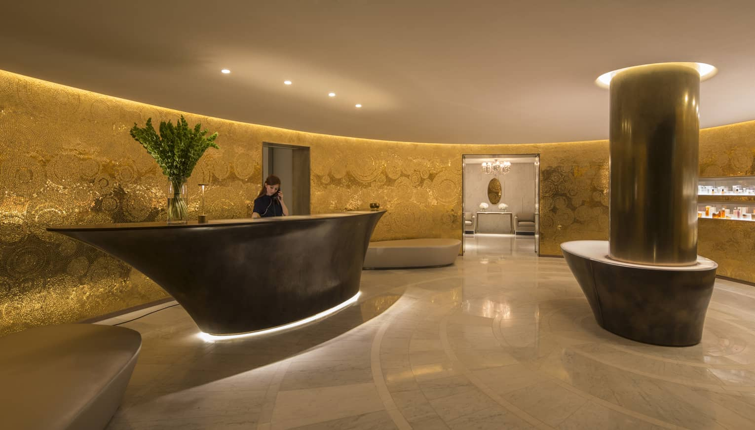 Lobby at the Spa with gold walls and modern details