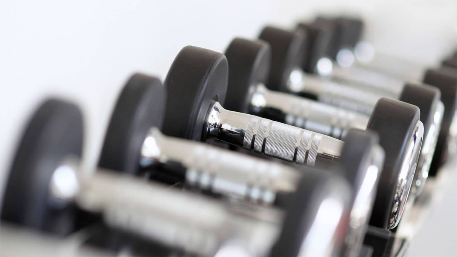 Close-up of hand weights in row on rack in Fitness Centre