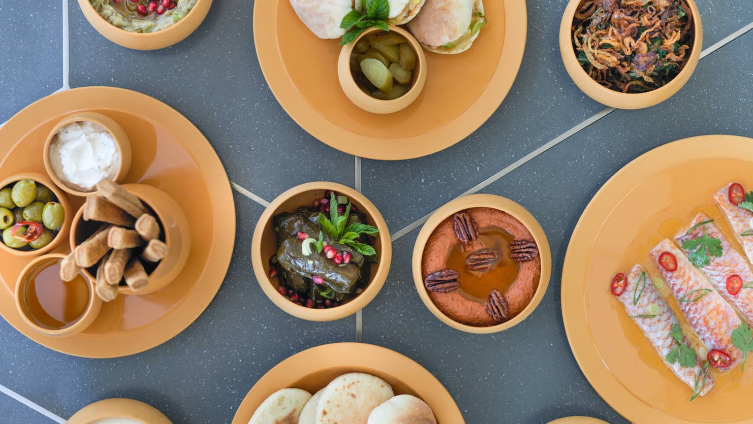 Aerial view of table with small bowls with hot and cold Lebanese mezze dishes