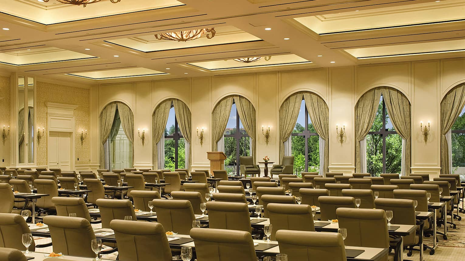 Rows of leather executive chairs, tables in Four Seasons Ballroom meeting room