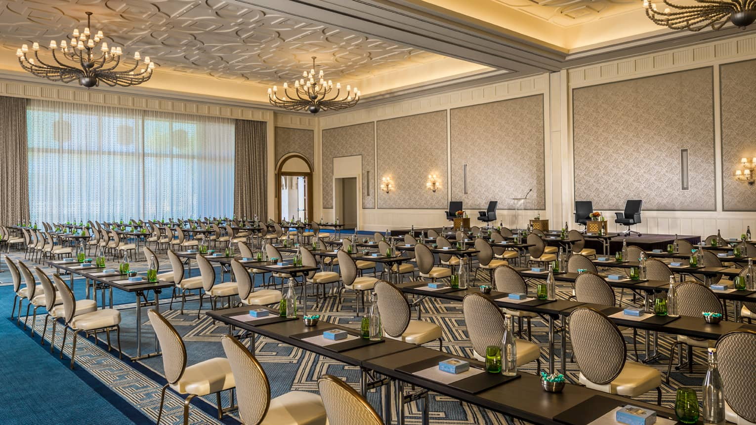 Rows of chairs, meeting tables in large Dana ballroom event space with high ceilings, chandeliers