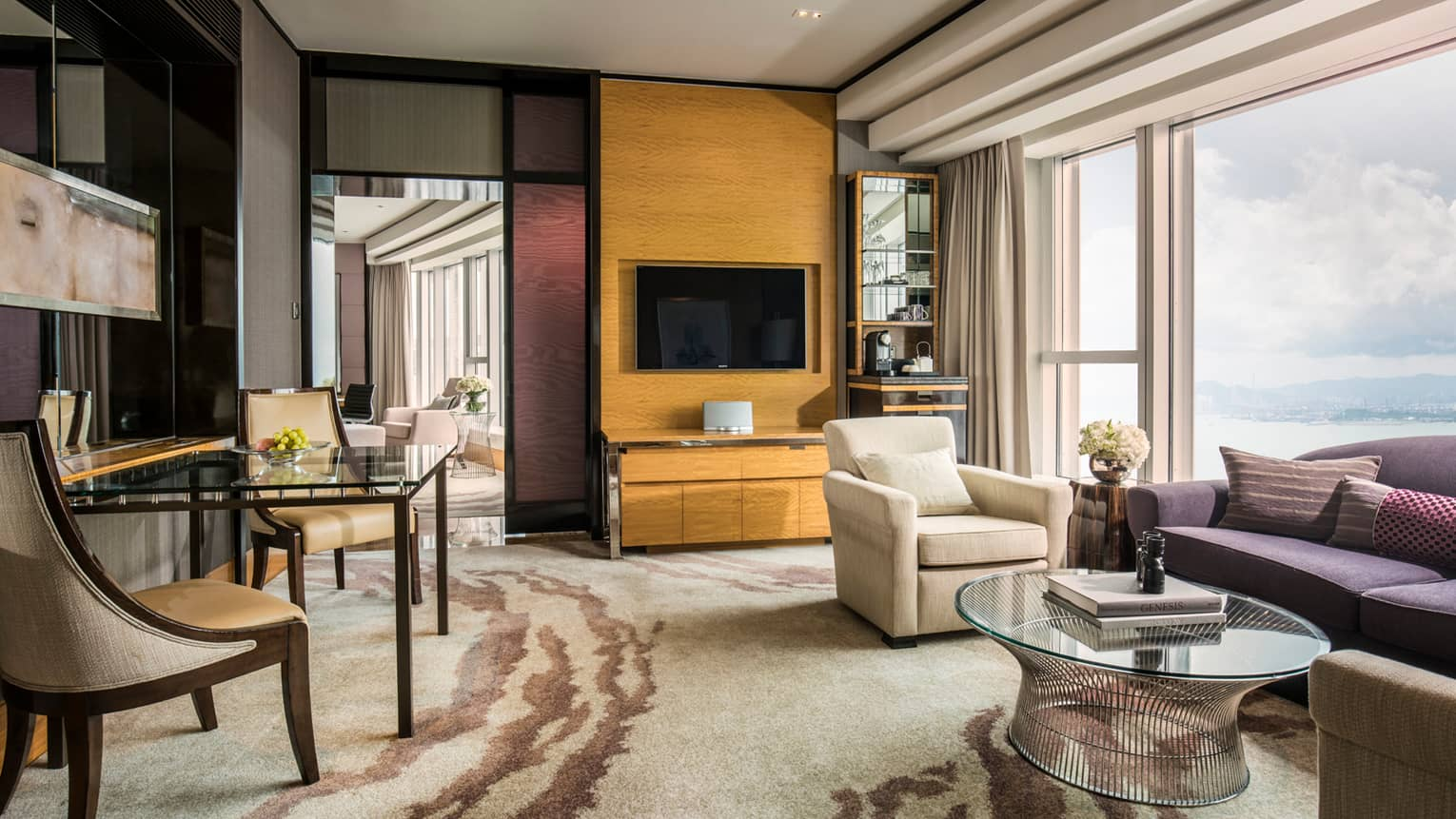 Grand Harbour-View Suite spacious living room and door to dining room, floor-to-ceiling windows with harbour views
