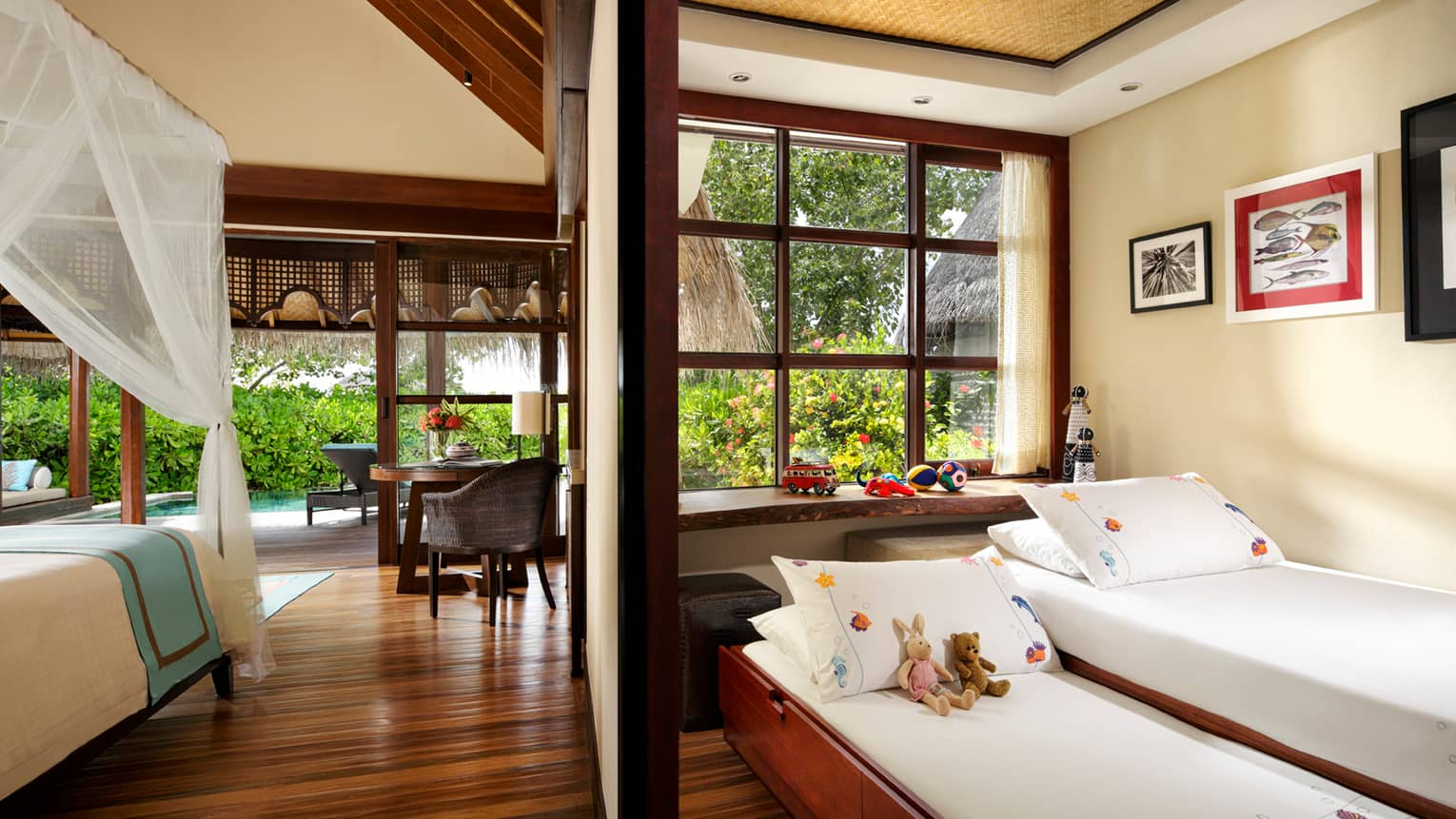 Sunrise Family Beach Bungalow, two kids beds and toys beside bedroom with canopy bed