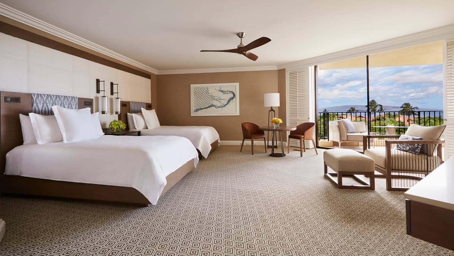 Bright Club Ocean-View Room bed with two-seat dining table, armchair and lanais with ocean view