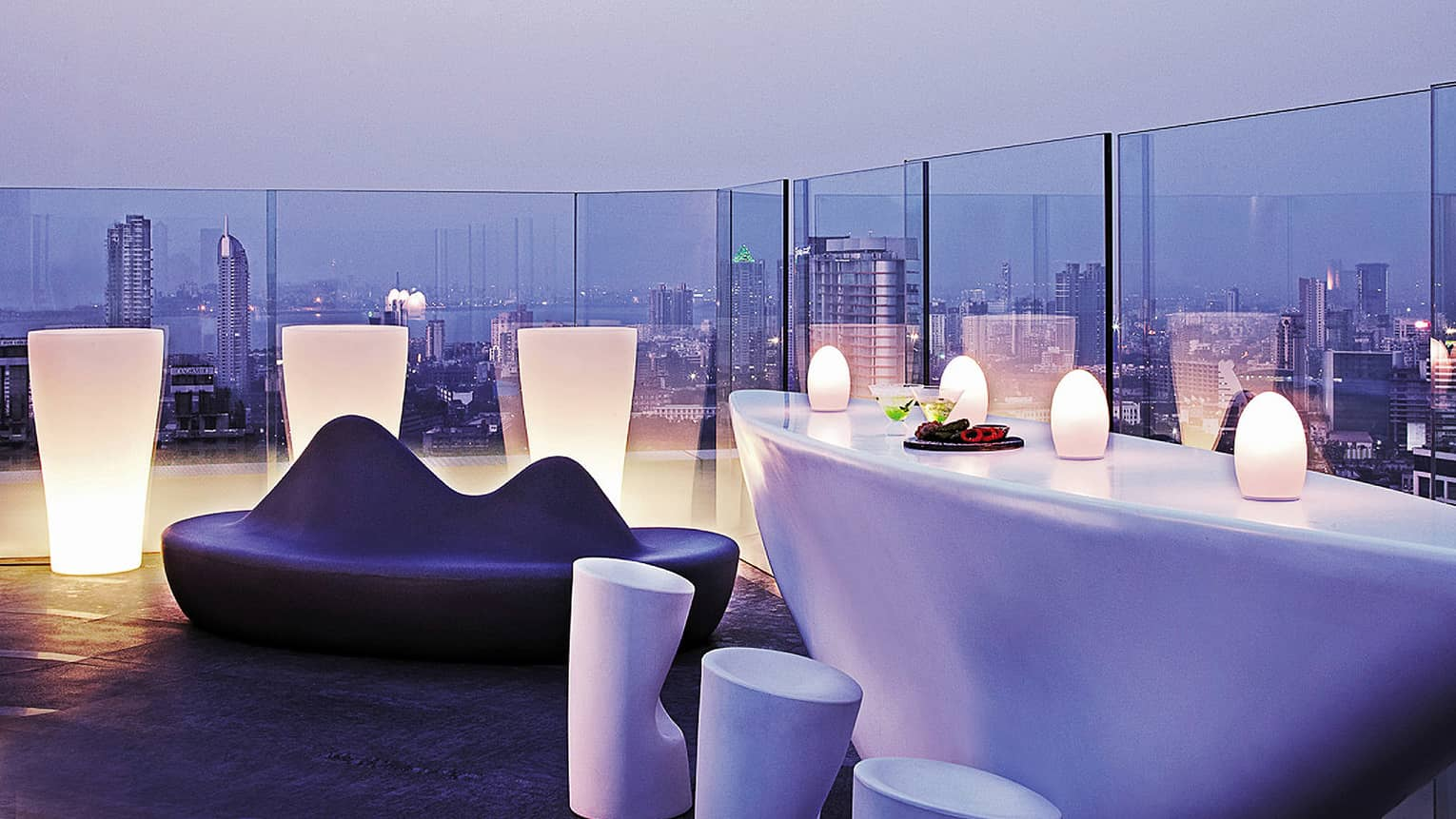 AER Rooftop bar with city skyline view