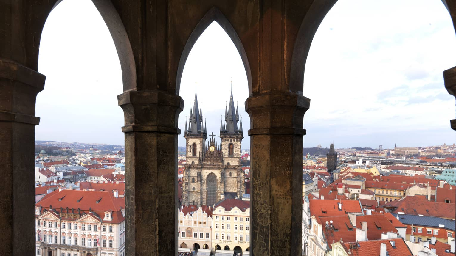 Old Town Prague, view past historic posts over city rooftops