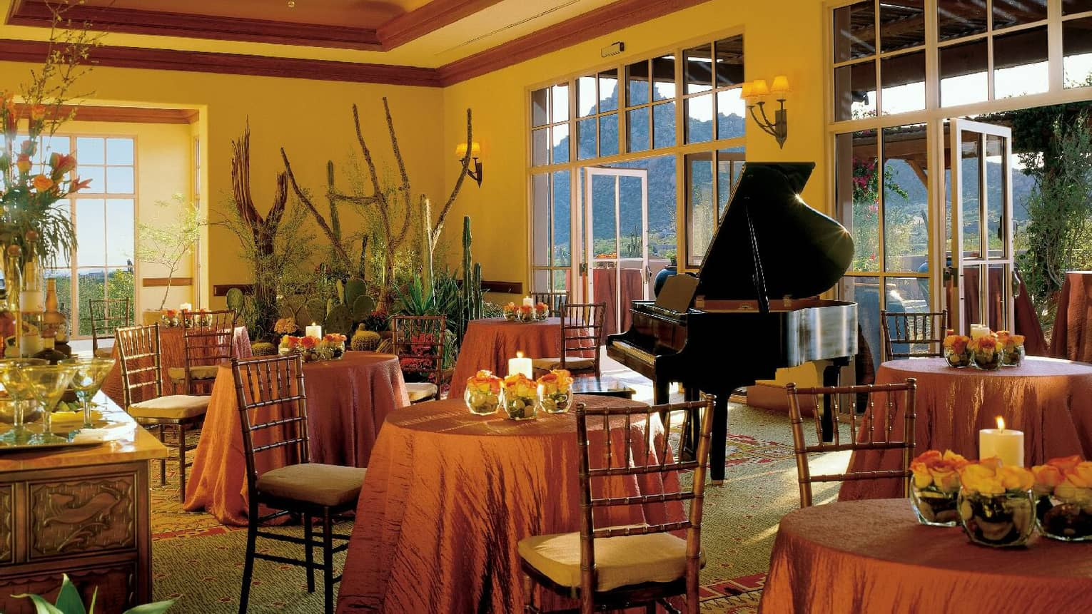 Ironwood foyer with small banquet tables with flowers and candles around Baby Grand piano