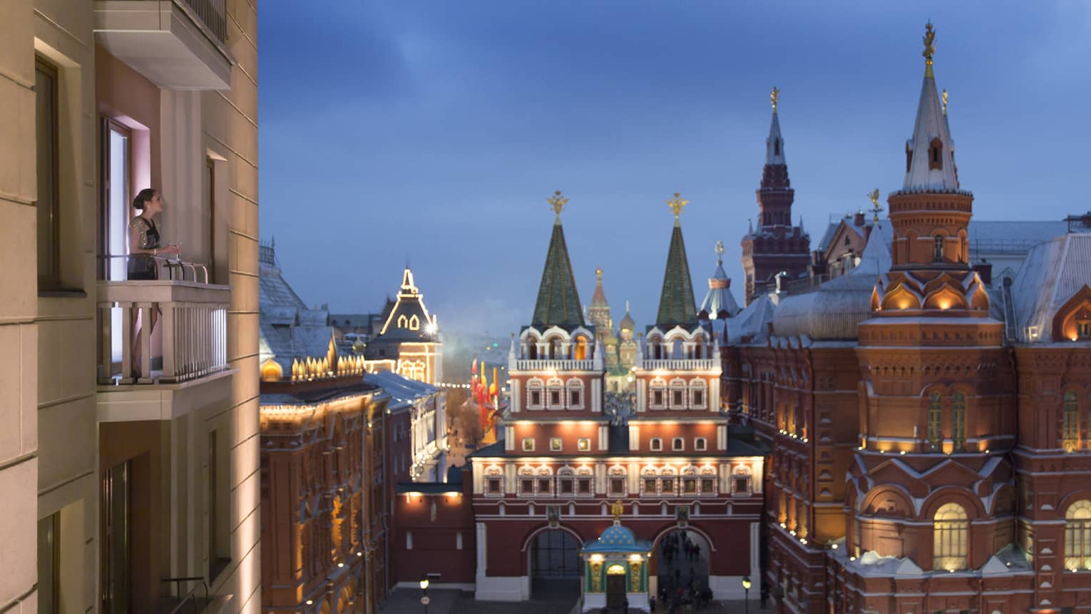 A view of Moscow's ornate buildings at dusk from the Grand Premier Suite Balcony