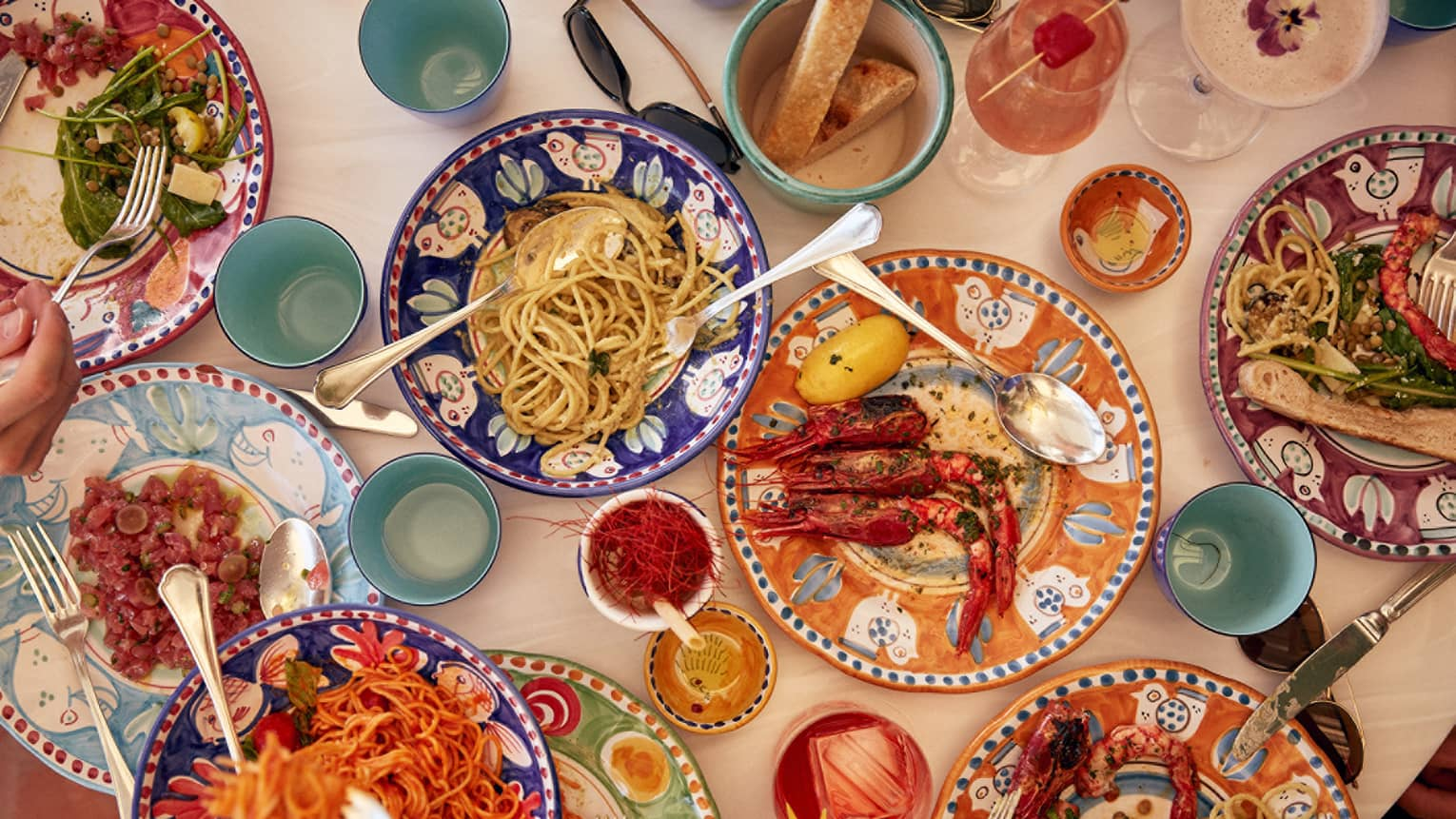 Smorgasbord of colorful plates boasting various types of seafood