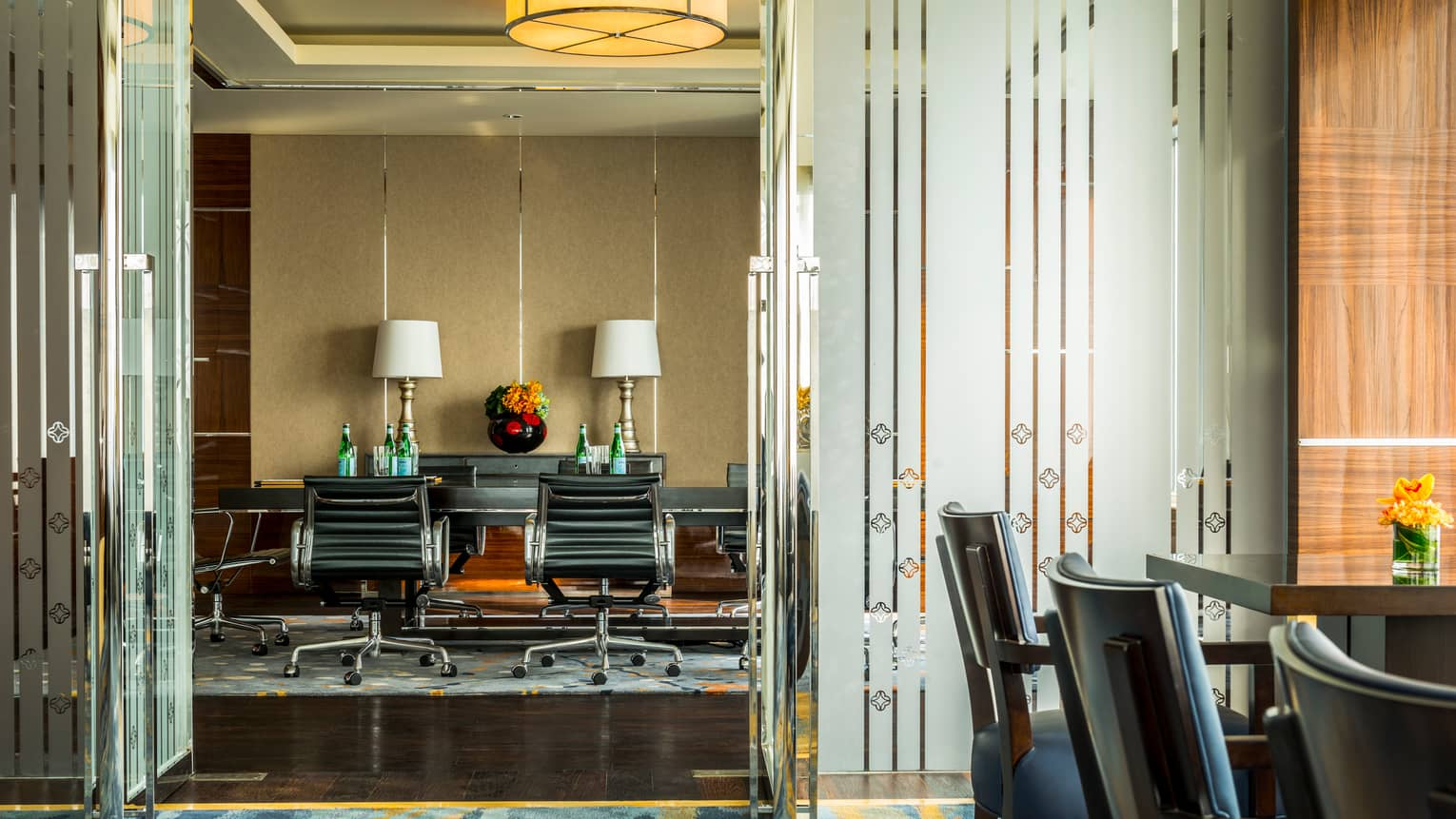 Executive Club Lounge boardroom, leather chairs on wheels around meeting tables
