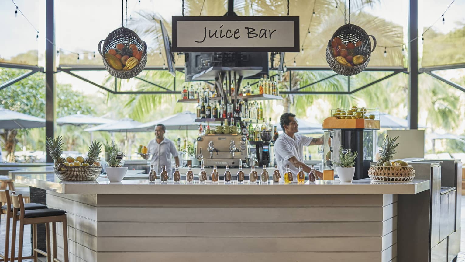Baskets of fruit adorn the exterior of the wooden paneled juice bar