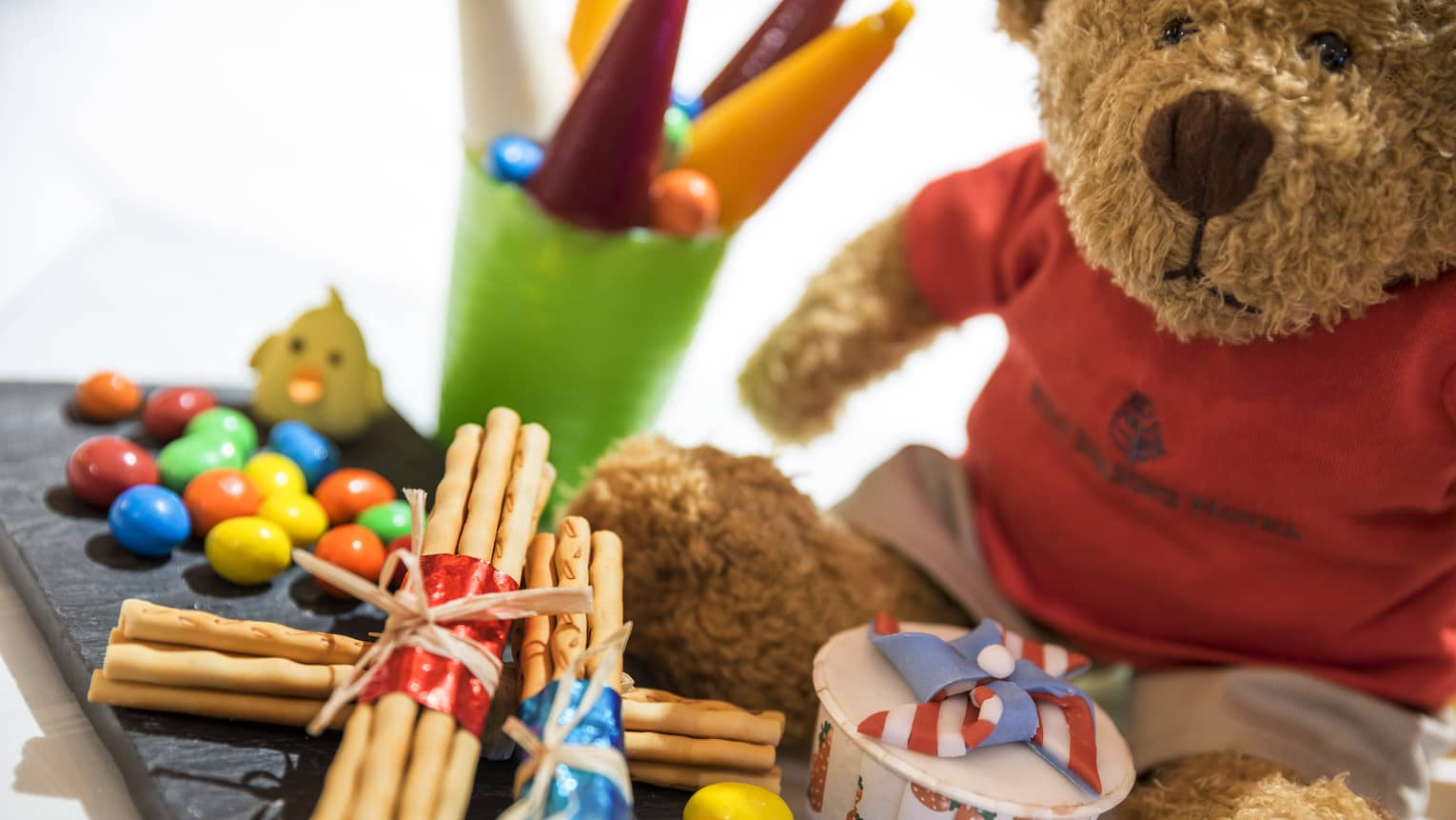 Children's gift package with teddy bear, candy and snacks