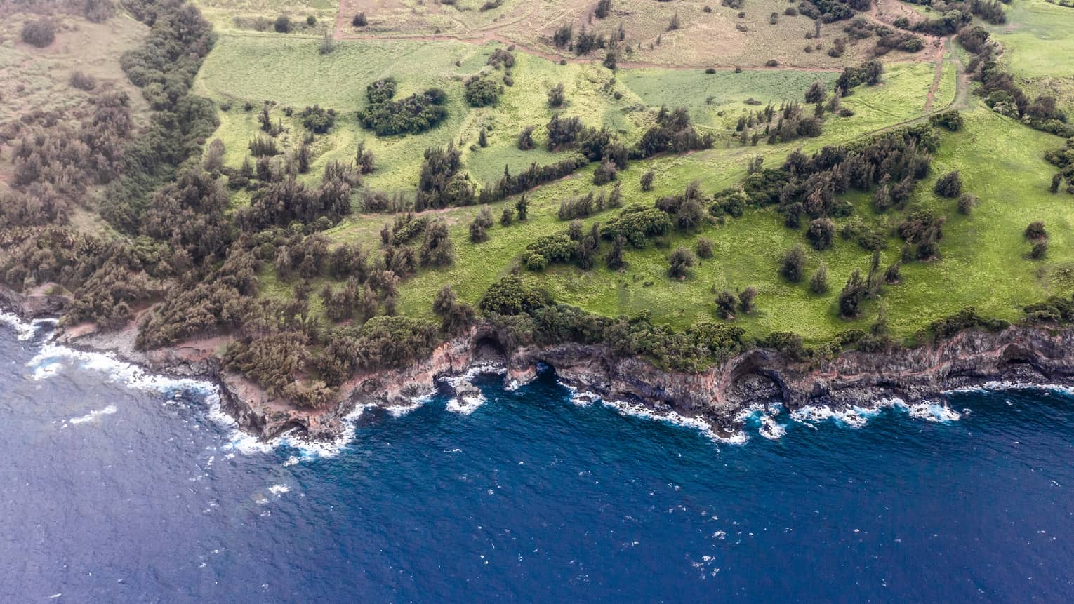 Aerial view of Hualalai, Hawaii rocky shoreline and ocean
