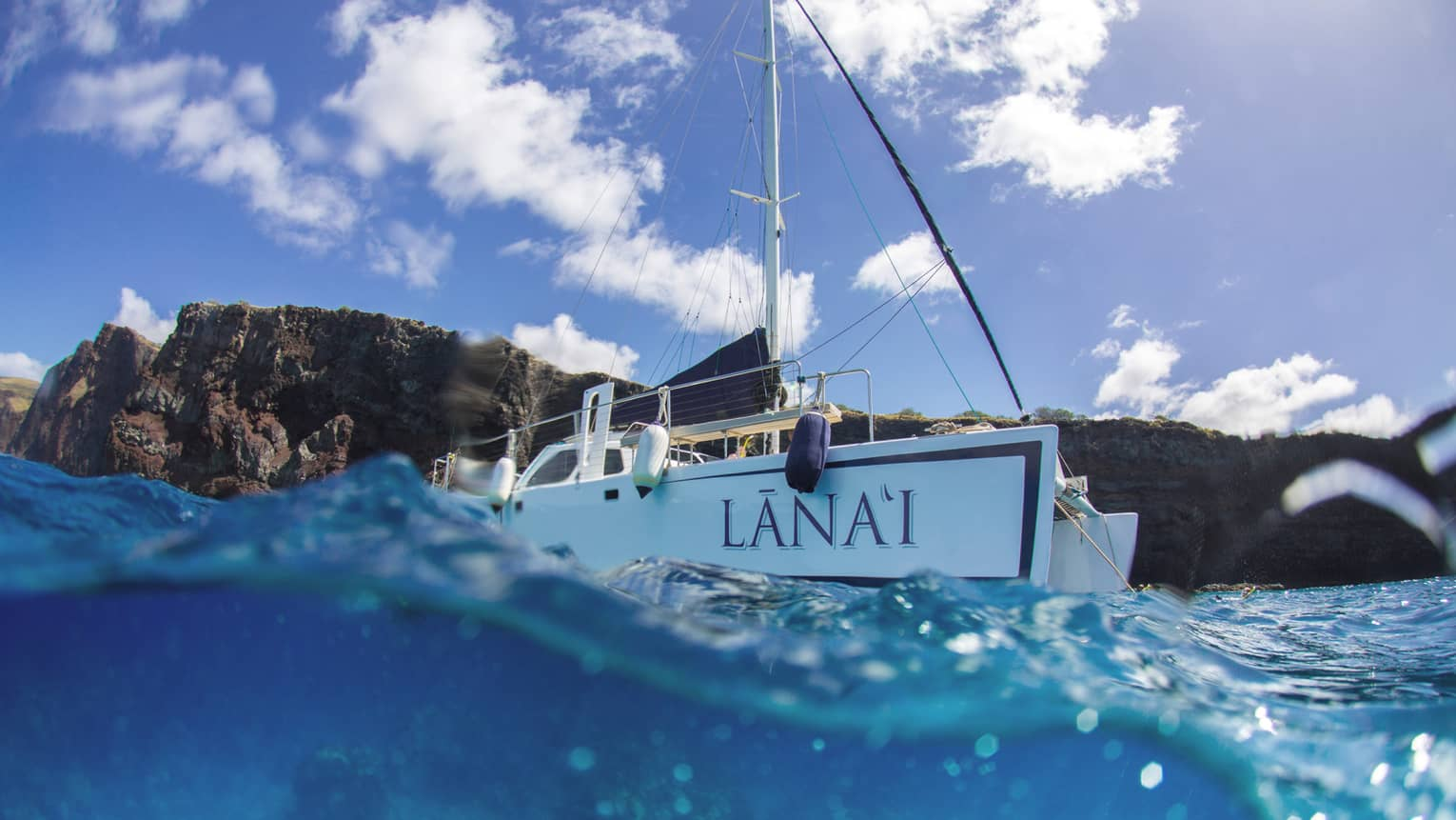 Lanai catamaran on blue waters headed out to sea