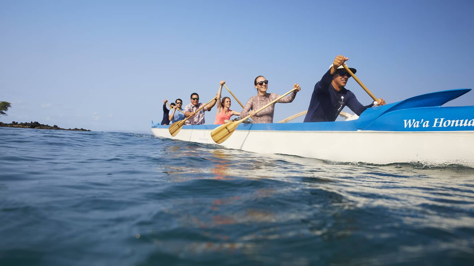 A group of guests kayaking on the ocean