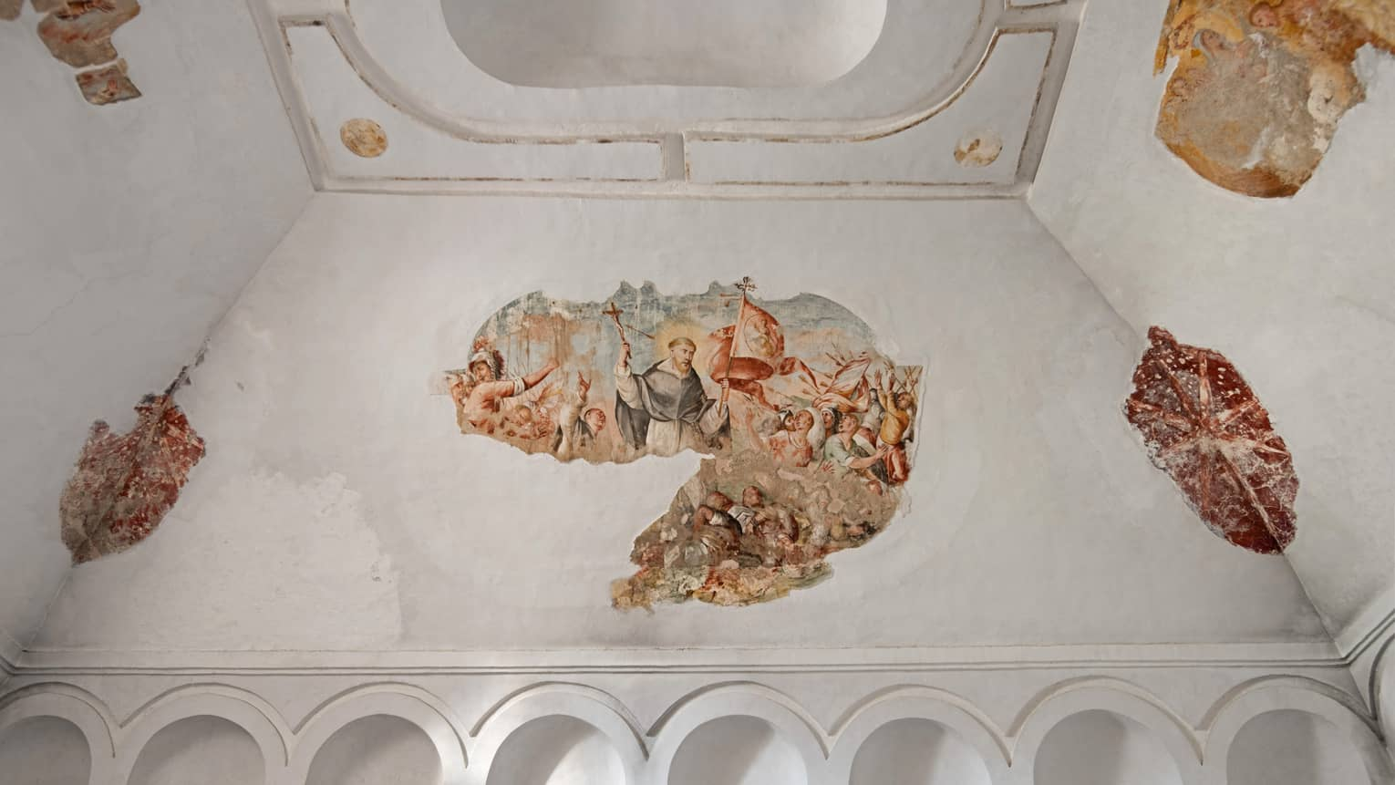 Ancient frescos on a white stone ceiling