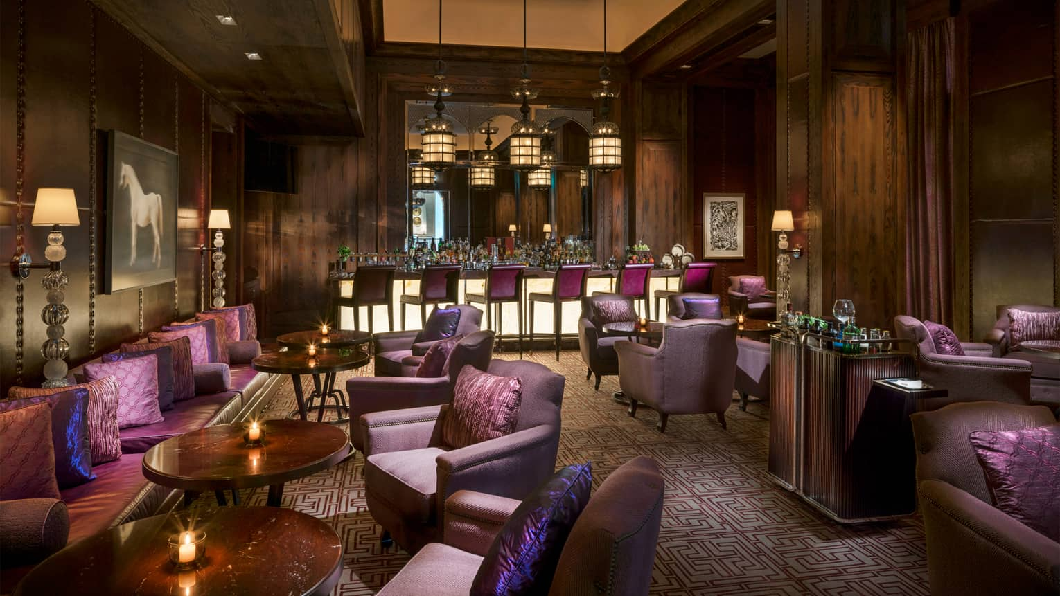 Hendricks Bar dimly-lit cigar club lounge with rich wood and purple decor