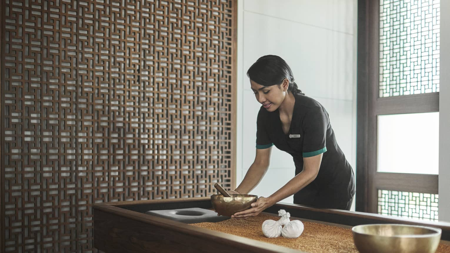Pear Spa staff places copper bowl on table