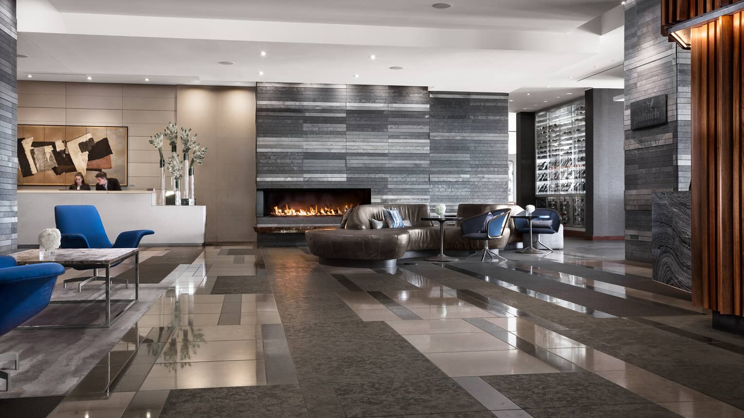 Stone tiles, marble floor, leather sofas in modern hotel lobby