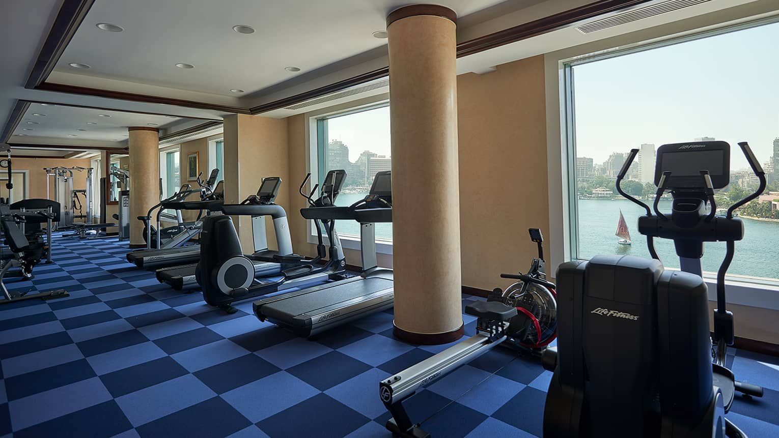 Row of cardio machines in front of window overlooking Nile river