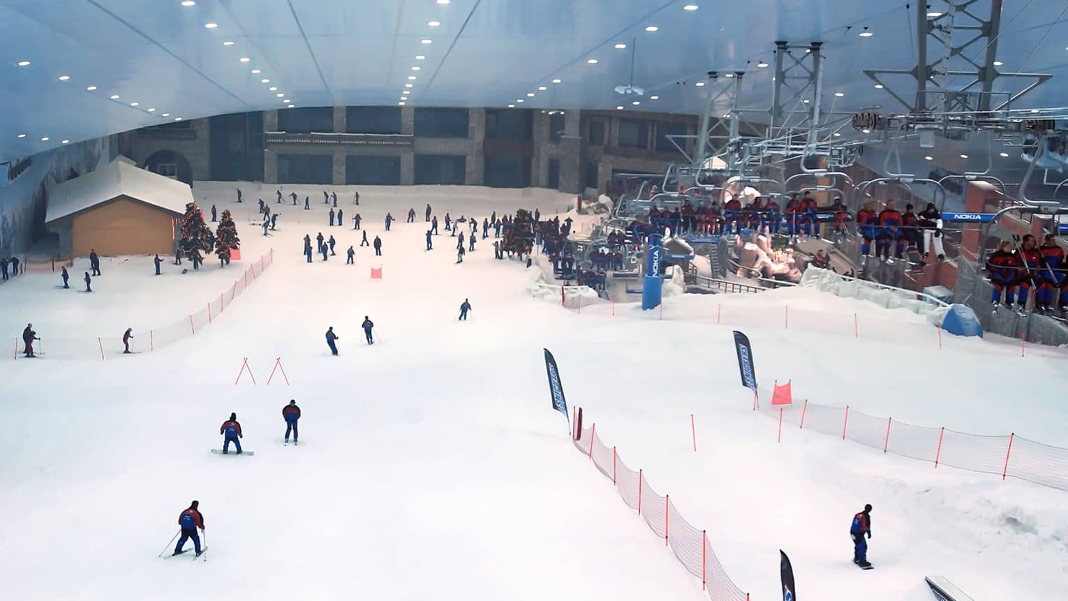 Aerial view of people skiing down slopes at indoor ski park