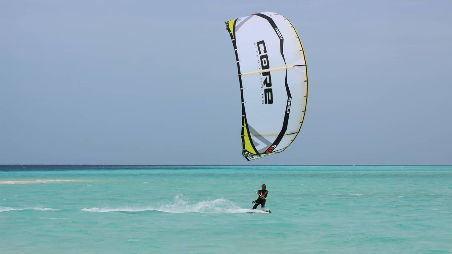 Windsurfer on blue ocean