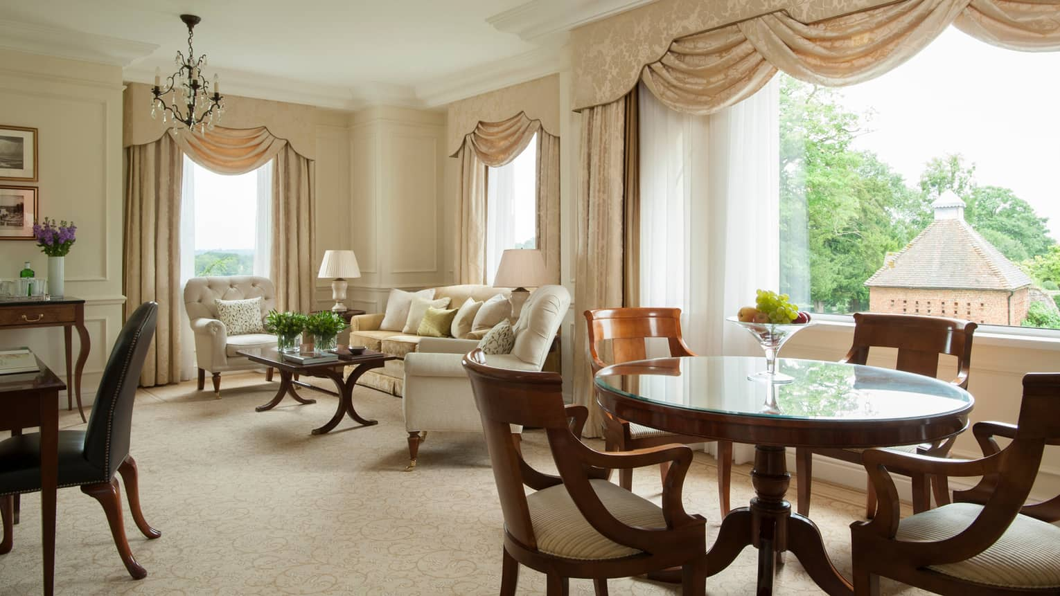Park Suite tall sunny windows with silk curtains, seating area, dining table