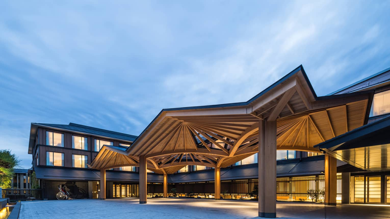 Modern awning over Four Seasons Hotel Kyoto entrance at dusk