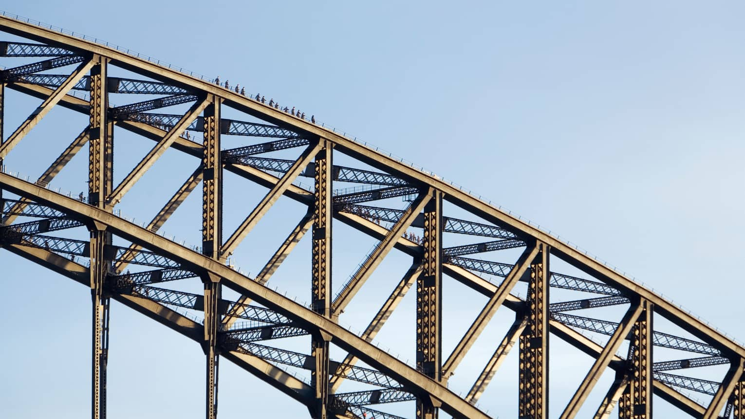 Close-up of people walking on top of Sydney Harbour Bridge