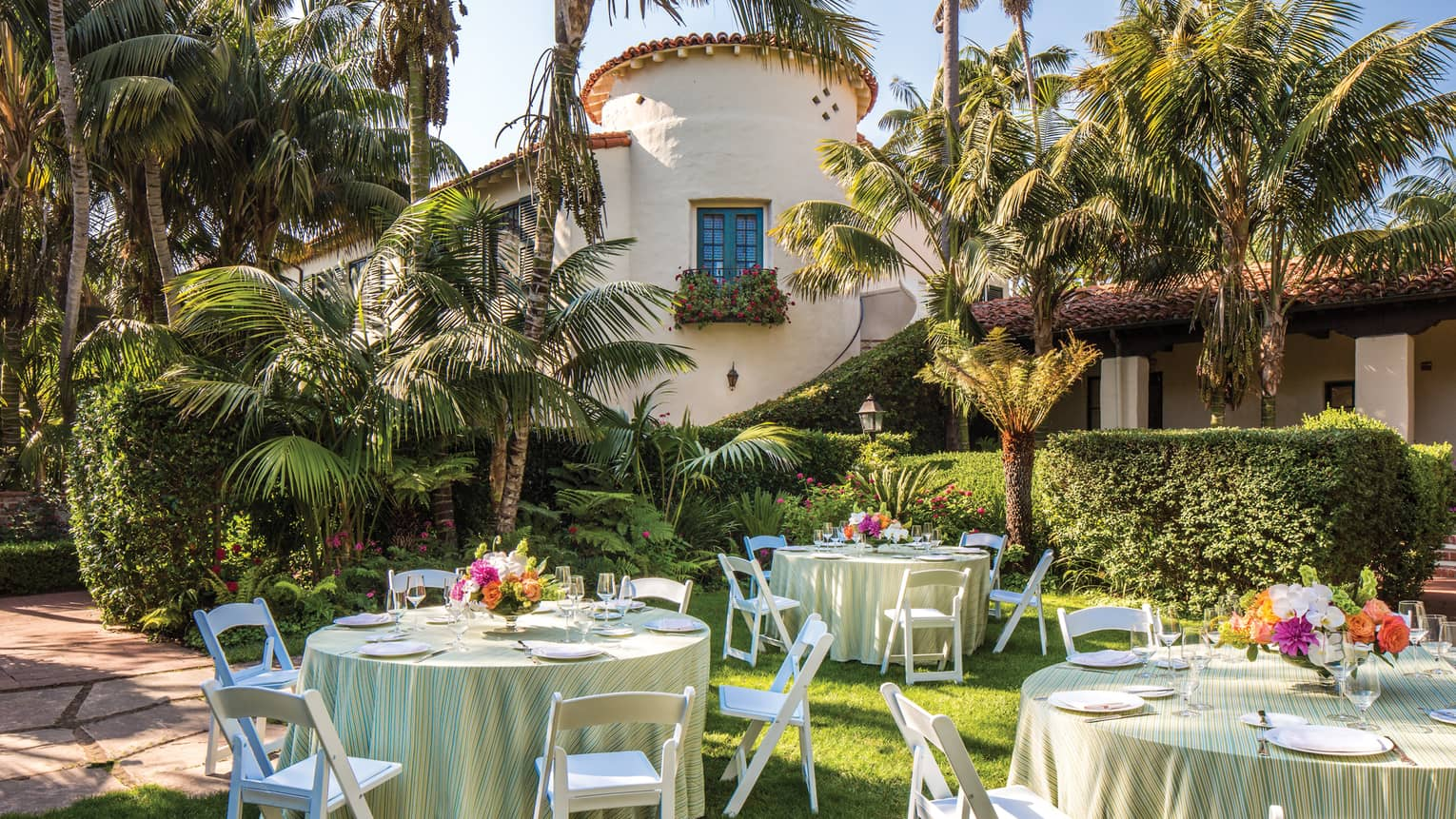 Escala Garden banquet tables on lawn under palm trees