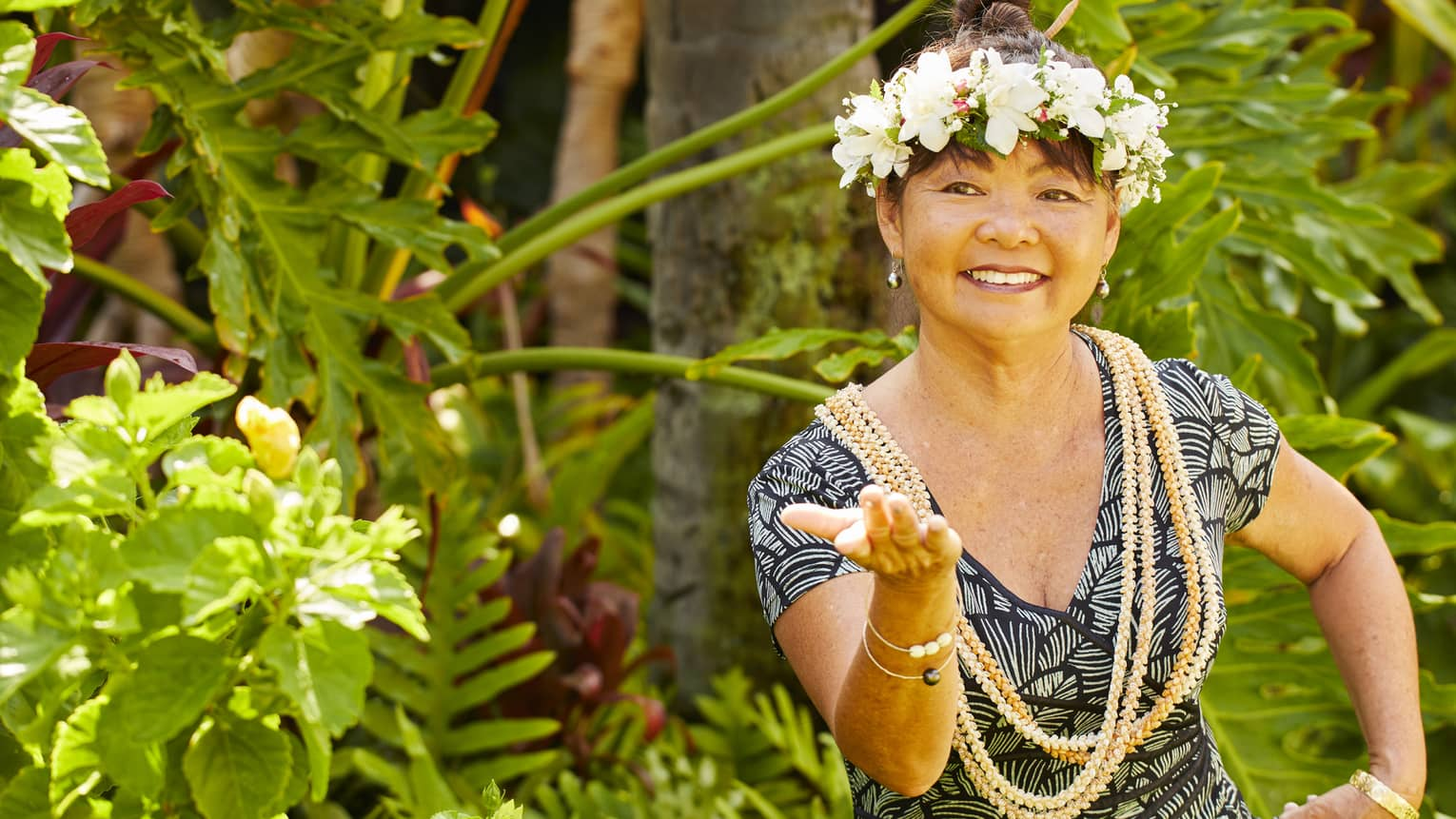 A woman practices hula with a flower crown