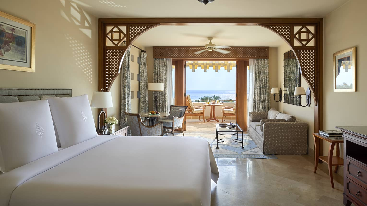 Sea-view room with living area, tan floors and intricate molding