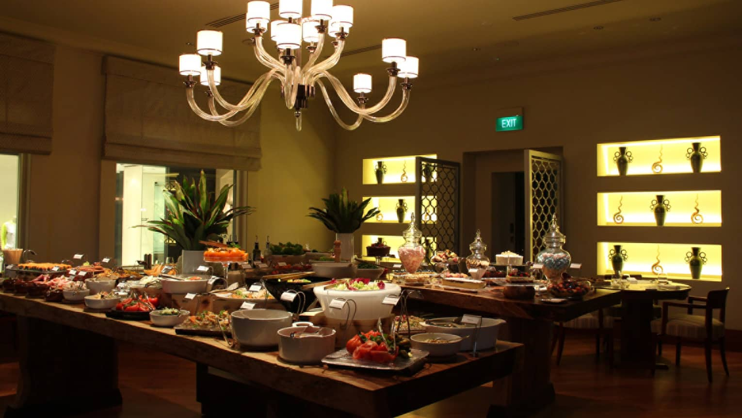 One-Ninety Restaurant buffet tables with large dishes with meals, desserts, tall vases with flowers
