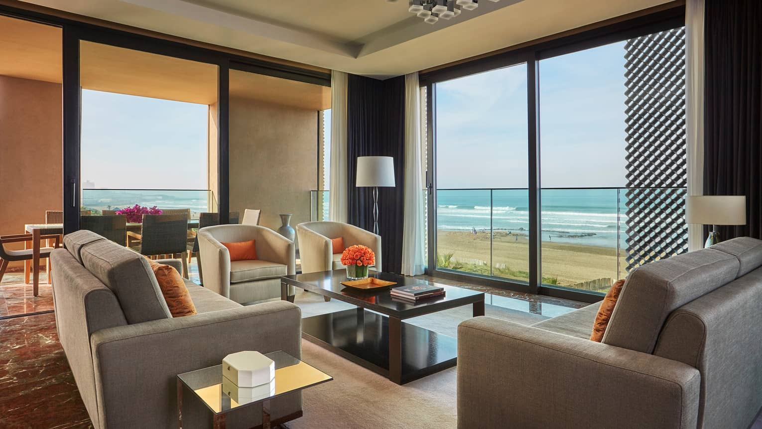 Imperial Suite Ocean View living room sofas, armchairs, corner windows with view of beach, Atlantic