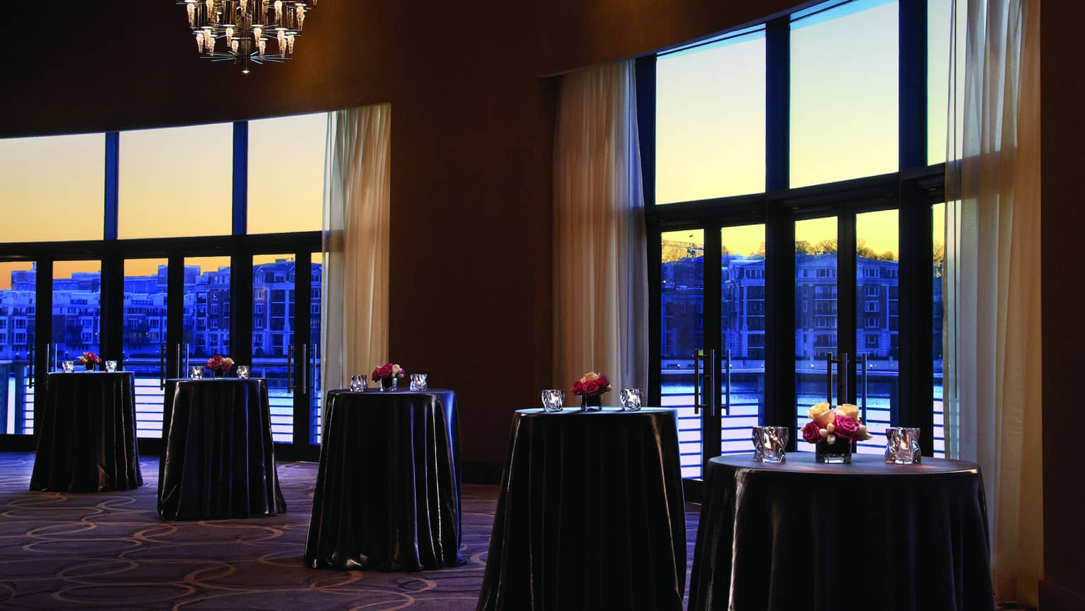 Sunset views by cocktail tables in Grand Ballroom pre function space