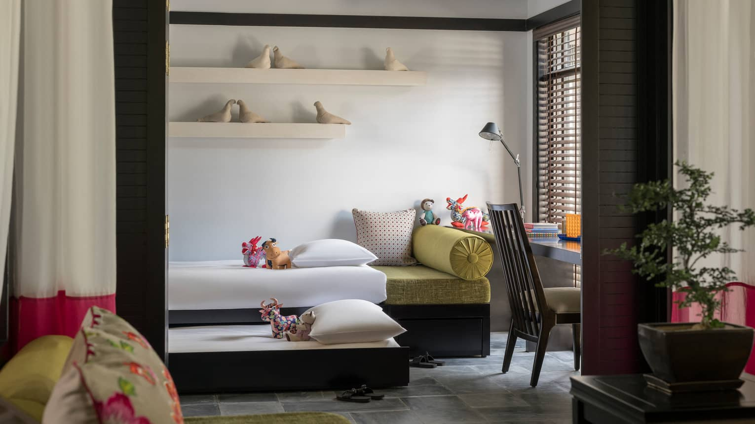 Family Villa bedroom with two children's day beds, ceramic birds on shelves