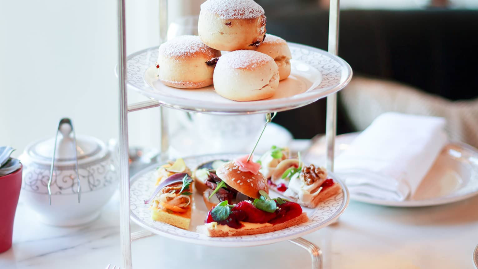 Dogmersfield Breakfast Tea dessert tray with scones, small slider sandwiches