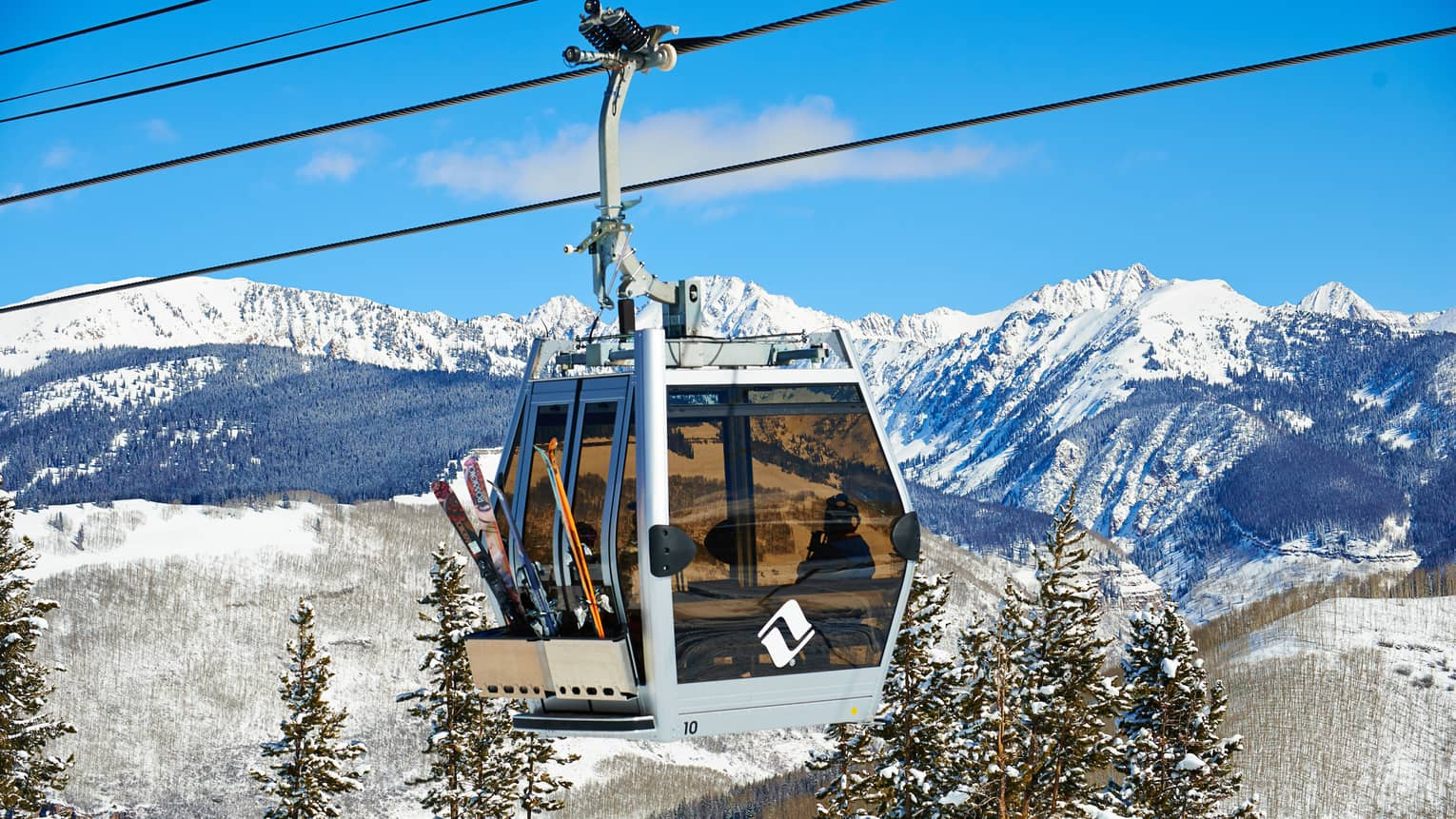 Ski lift heads uphill on snowy Vail, Colorado mountain