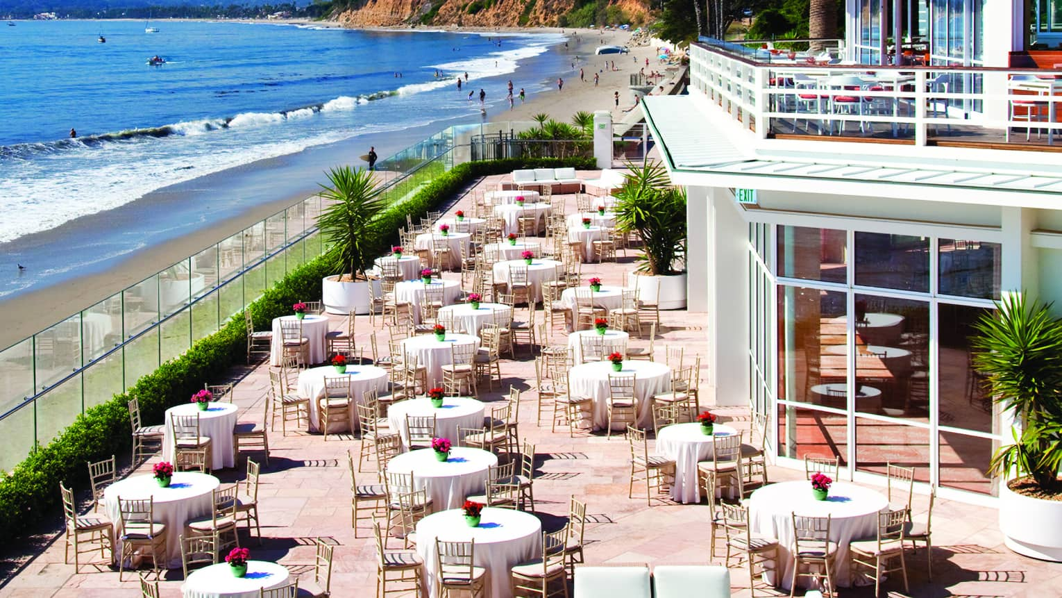 Aerial view of dining tables on large LaPacifica Terrace overlooking ocean